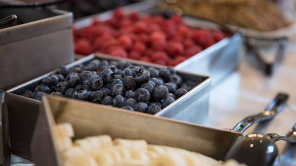 containers of blueberries and raspberries