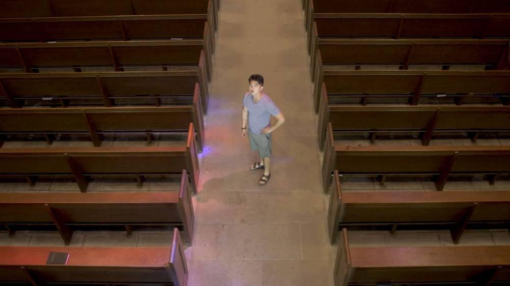 Christian Shin standing in chapel