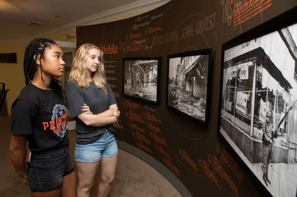 Ann Bogdan and Masha Miura looking at timeline of 1967 Newark riots