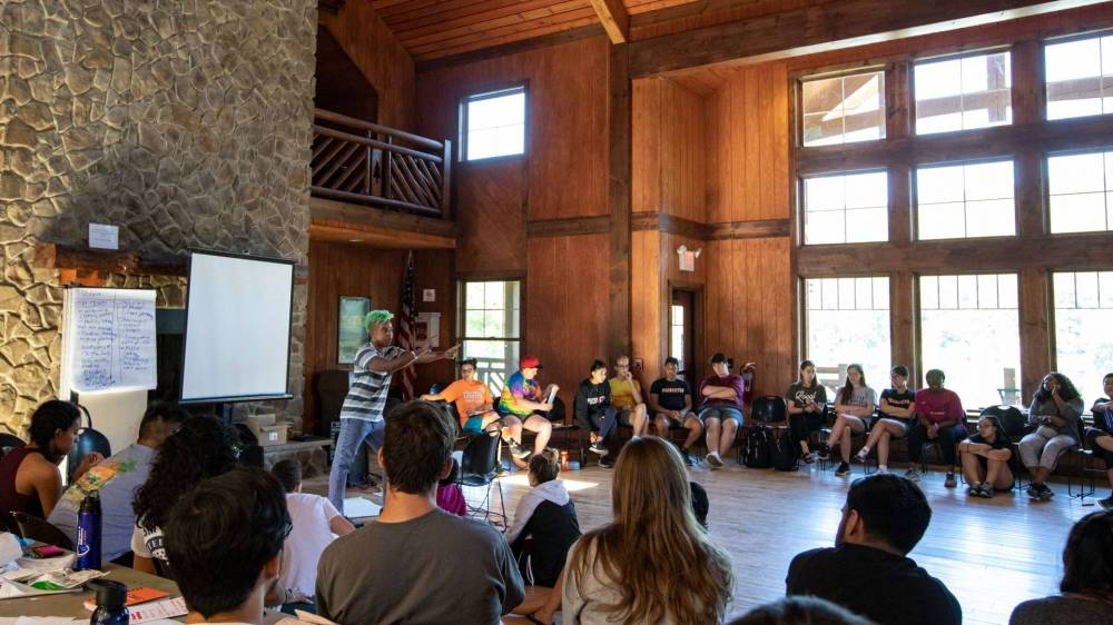 Students participating in Dialogue and Difference in Action workshop in YMCA lodge