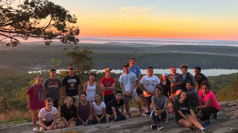 Students posing after a sunrise hike
