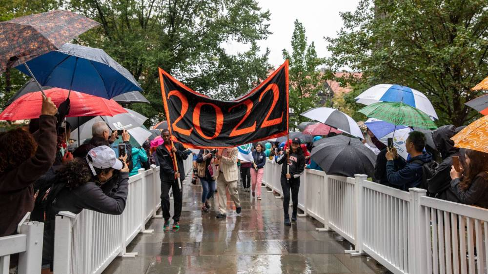Students carrying Class of 2022 banner through Pre-rade