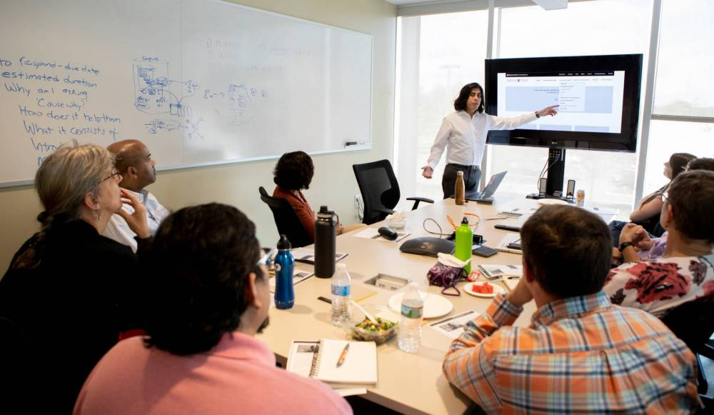 Josh Cartagena speaking to Princeton employees