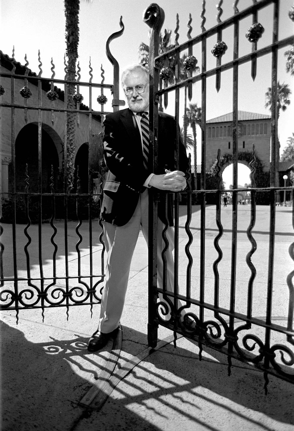 9/27/1996 Professor of English John L'Heureux at one of the iron gates in the Quad.