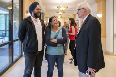 Baltej and Rupinder Singh of San Jose, California, meet Dean of Admission Rick Shaw while they wait at Parents' Check-In at the Arrillaga Alumni Center.