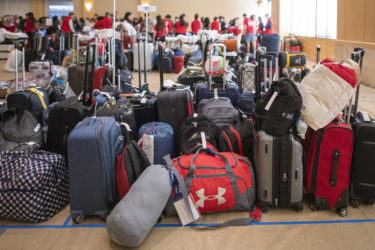 Luggage is kept at the Alumni Center until the prospective students set off for their dorm assignments.