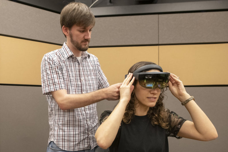 Mark Miller works with lab manager Talia Weiss