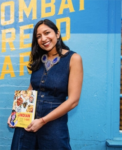 Priya Krishna holding a copy of her book