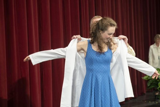 Student receives white coat