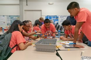 Students competed to build the strongest bridge at the Oshman Engineering Design Kitchen.
