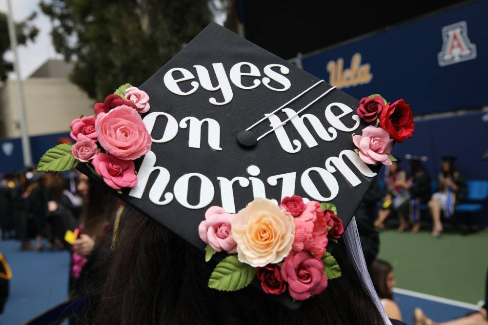 Eyes on the horizon, mortarboard reads