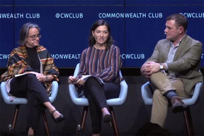panel of three people sitting on stage