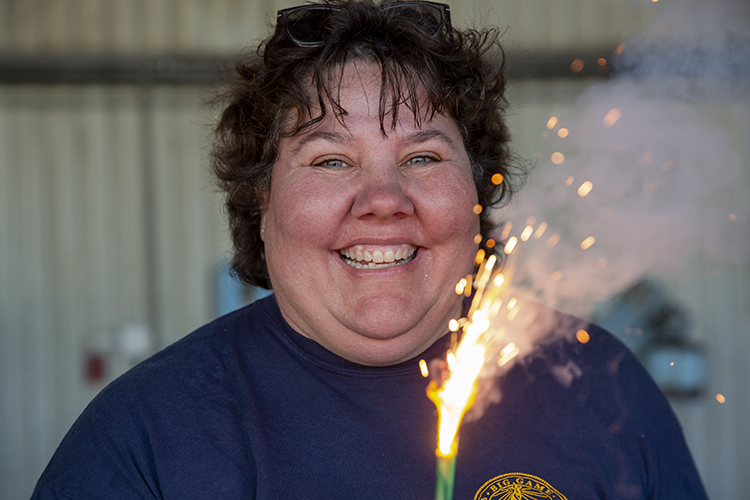 Maya Goehring-Harris oversees the cannon crew and works on fireworks crews on July 4