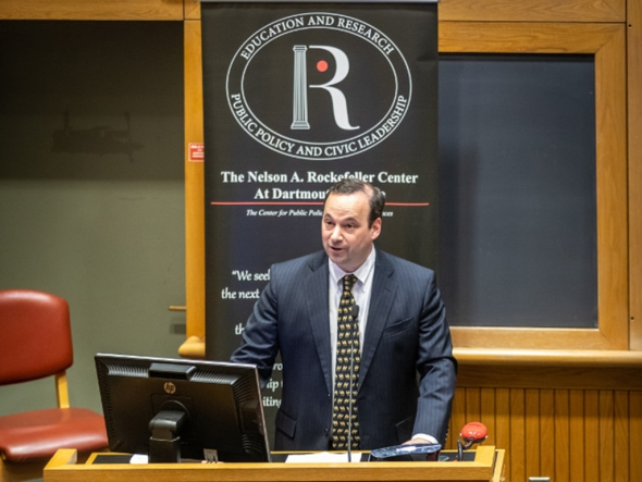 Rockefeller Center Director Andrew Samwick standing at a podium, introducing a public policy discussion at the center