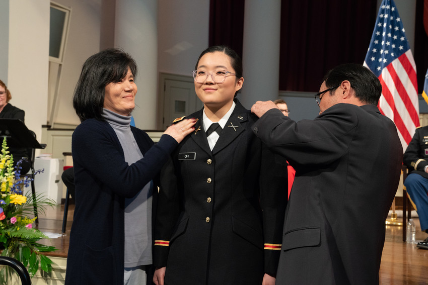 woman in military uniform with woman and man