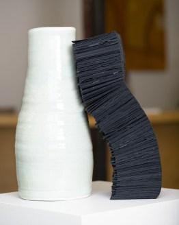 "Lara Head, ""Two vessels,"" 2019. Porcelain, Khadi black rag paper and waxed linen thread."