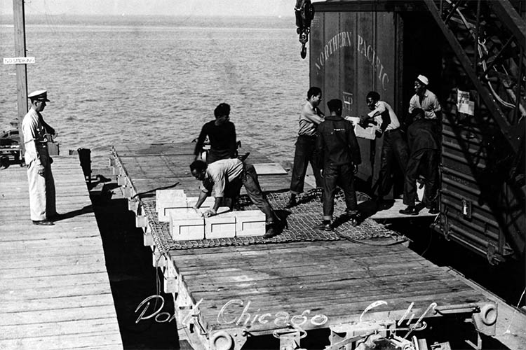 men load ammunition in a black-and-white photo