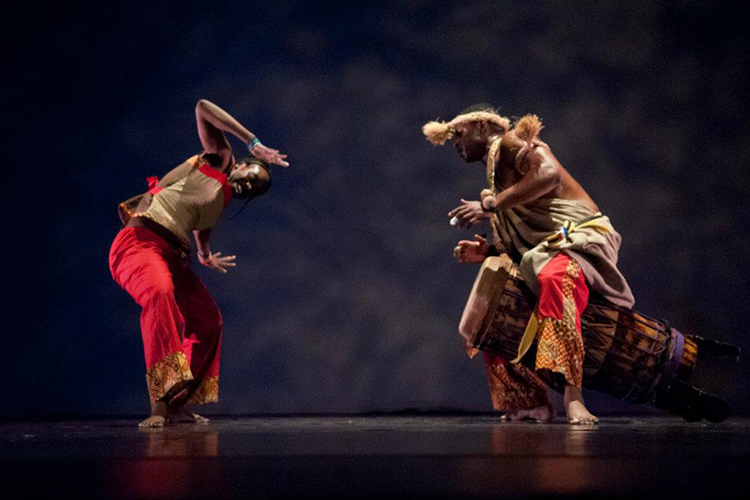 Dancers Latanya and Kiazi performing an African dance on stage