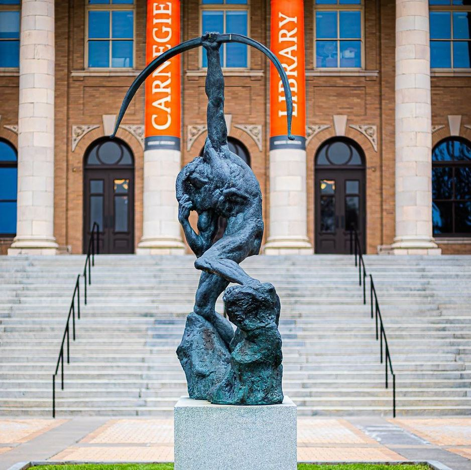 statue in front of Carnegie Library