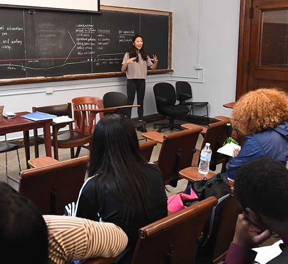 Young woman teaching a class