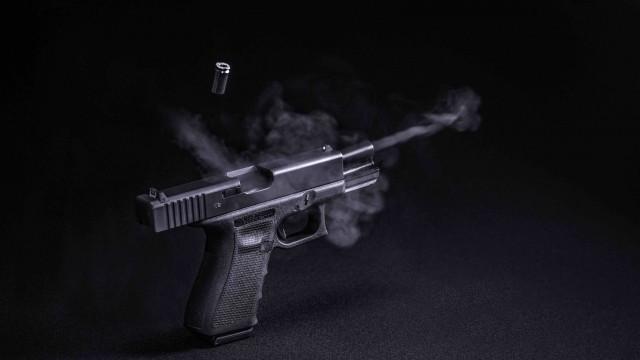 Image of a gun being shot