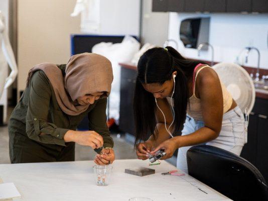 two women working on making jewlery