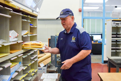 Mike Combs sorting mail