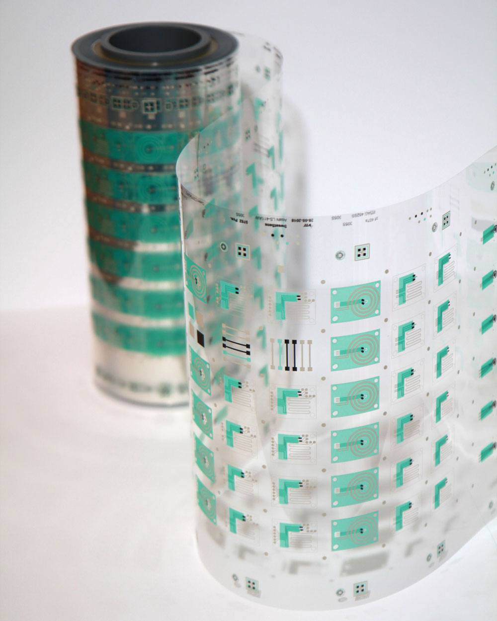 A photo of the sensors printed on a transparent sheet of plastic