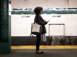 woman waiting for subway at W. 4th Street