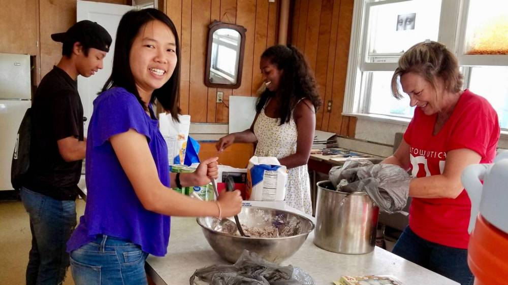 Irene Hsu and others making cookies