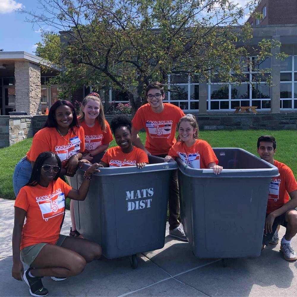 students in moving bins