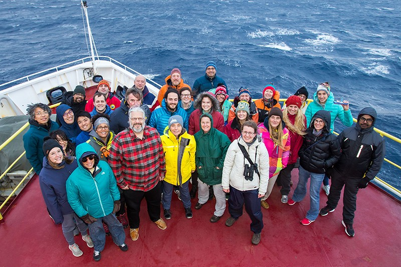 An aerial photo of the Joides Resolution Science crew at the bow of the ship.