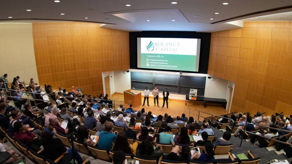 Teams presenting in an auditorium