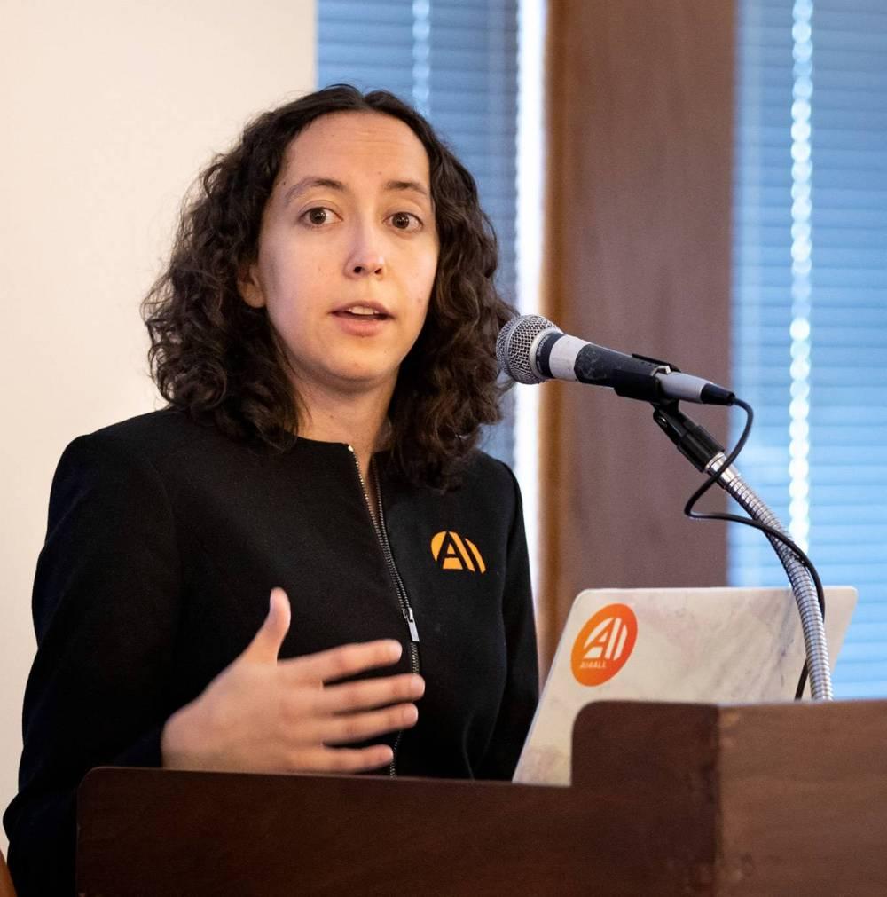 Professor Olga Russakovsky speaking at the podium