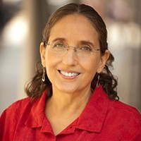 brown-haired woman with glasses and red shirt