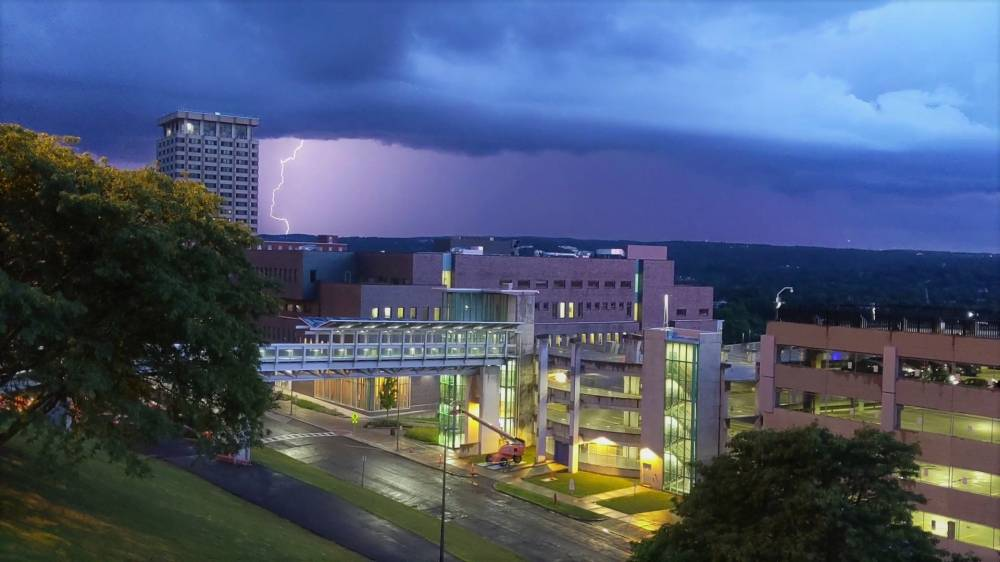 dark clouds and lightning strike over Dineen Hall