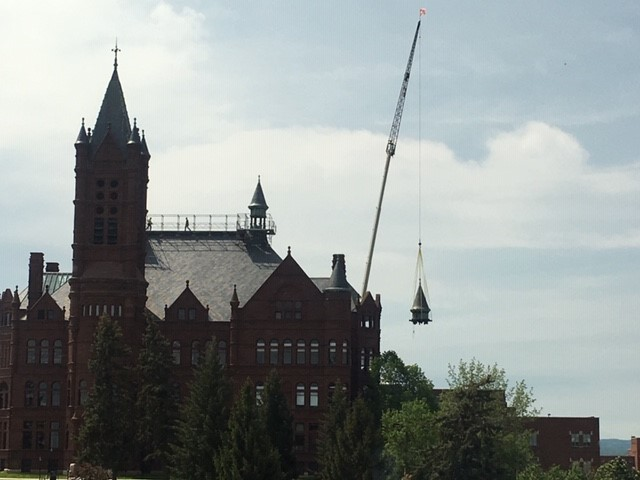 crane lifting cupola at Crouse College