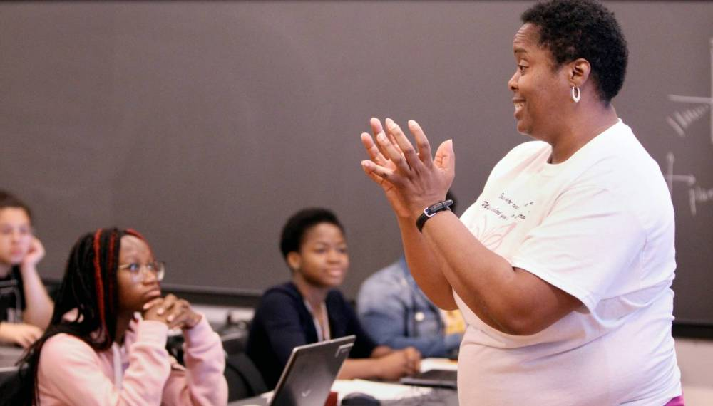 Joy Barnes-Johnson speaking in front of classroom