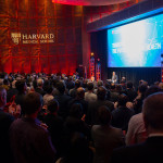 "President Larry Bacow (at podium) described the Harvard Medical School gift from the Blavatnik Family Foundation as an ""unprecedented act of generosity and support."""