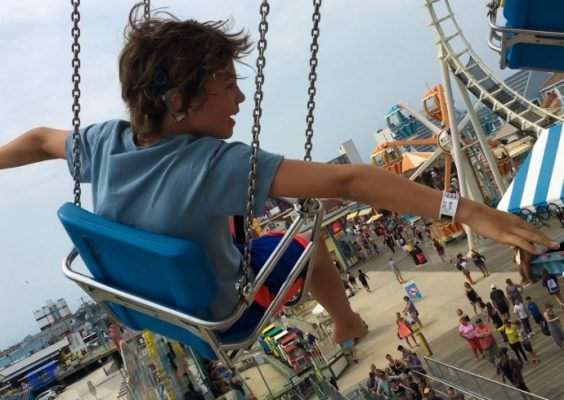 boy on swing at carnival