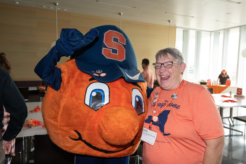 mascot posing with smiling woman