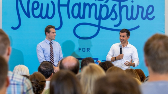 Dartmouth student and New Hampshire state Rep. Garrett Muscatel '20, left, moderated the question-and-answer period at a campaign event for South Bend, Indiana Mayor Pete Buttigieg, pictured right, at the Hanover Inn in August.