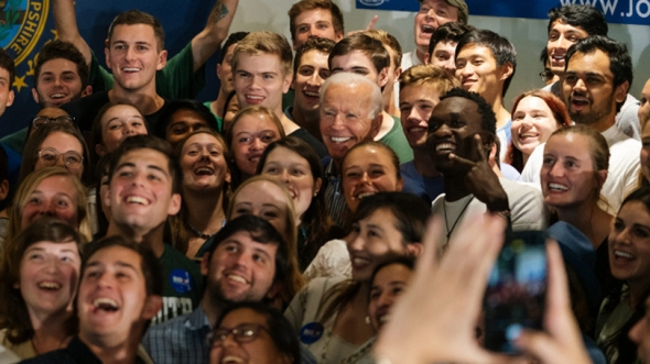 Former Vice President Joe Biden (D-Del.) poses for a group selfie with Dartmouth students after his town hall event in Alumni Hall in August.
