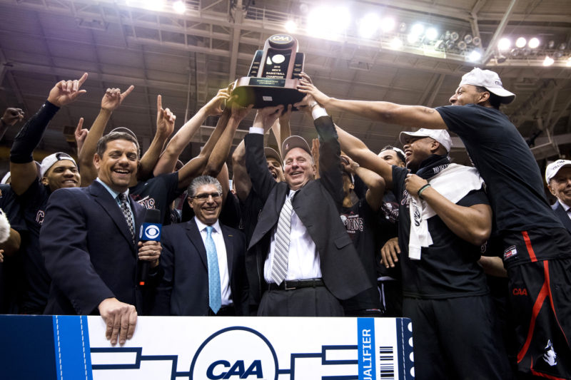 Northeastern coach Bill Coen and his Huskies celebrate their ticket to March Madness on Tuesday, March 12, 2019. Photo by Matthew Modoono/Northeastern University