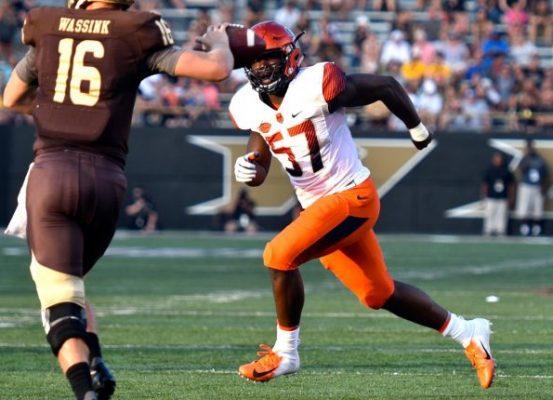 football player running down field
