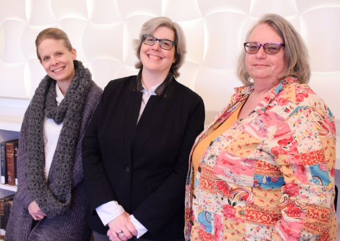 three women standing side by side