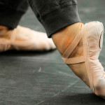 """Feet of a dancer in the """"B-Plus"""" position."""