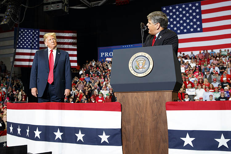 trump on stage with sean hannity