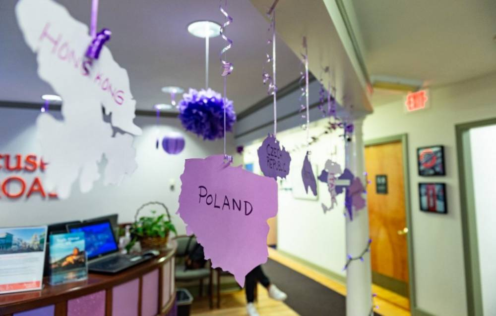 purple decorations hang from ceiling of office