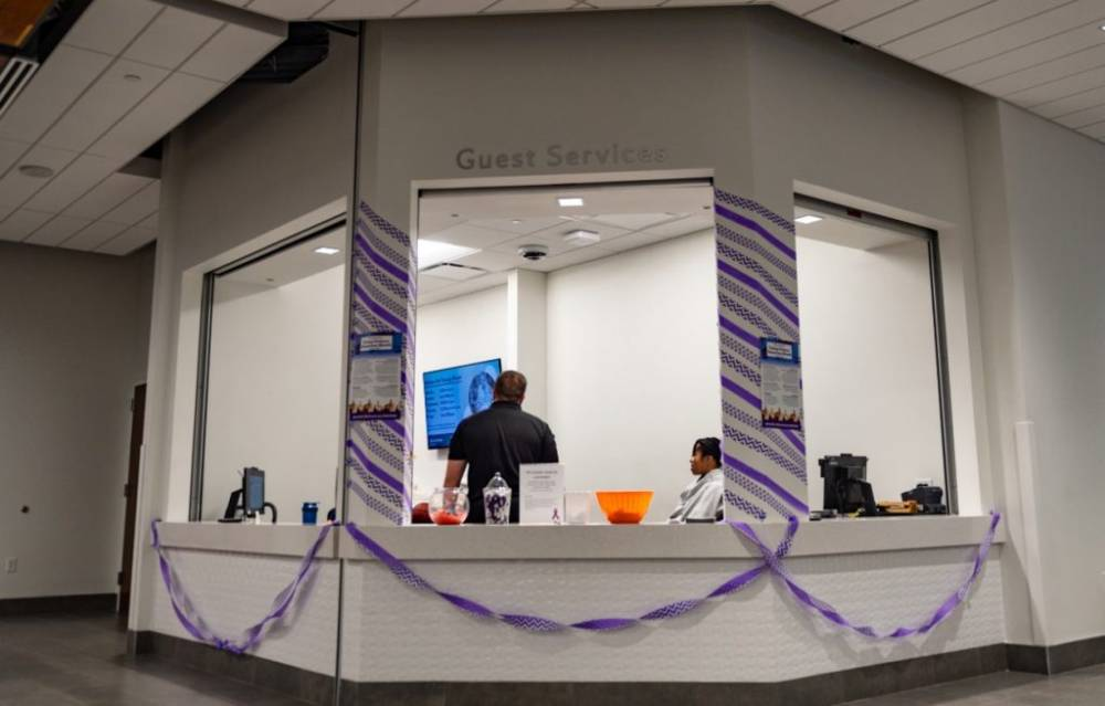 Streamers and purple decor surrounds Guest Services kiosk